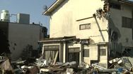 Stock Video Footage of Tsunami Damage To House In Kesennuma City Japan