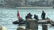 Stock Video Footage of Navy Divers Search For Tsunami Victims In Kesennuma City Japan