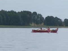 Lake shore and sailing holidaymakers filmed aboard motor launch. Stock Footage