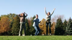 Young happy people jumping Stock Footage