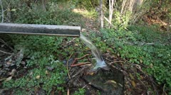 Mountain spring water from pipe P HD 0318 Stock Footage