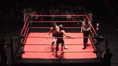 Sequence of pro wrestling moves - wide shot static - stock footage