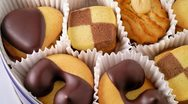 Biscuits in metal box closeup Stock Footage