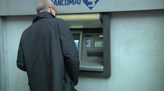 Man using ATM, Catania, Sicily, Italy - stock footage