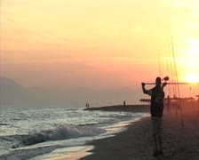 Fisherman throwing at sunset. Surf casting. Stock Footage