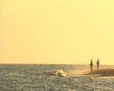 Fishers at the sunset. Surf casting. Stock Footage