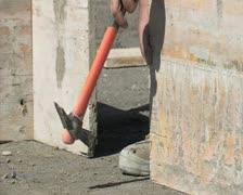 Bricklayer nailing nails formwork. Construction. Stock Footage