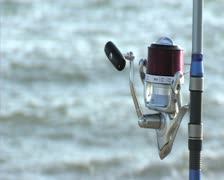 Reel with sea in background. Fishing and Surf casting. Stock Footage