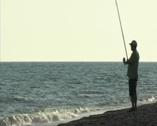 The fisher and the sea. Surf casting. Stock Footage