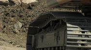 Excavator going on, close-up of the machine transmissions. Construction. Stock Footage