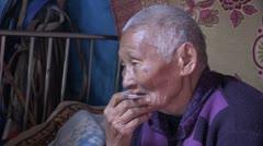Mongolia: Smoking Grandma Stock Footage