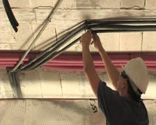 Mason or electrician placing cables in roof of construction. Construction. Stock Footage