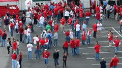 Large crowd of sports fans all wearing red or white Stock Footage