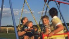 Family on swing (Vintage 8 mm amateur film) - stock footage