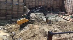 Construction pit with excavator Stock Footage