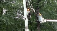 Stock Video Footage of Lineman pull cable during repair.