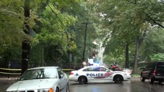 Police car (DC) blocks road of power line repair - Wide Shot Stock Footage