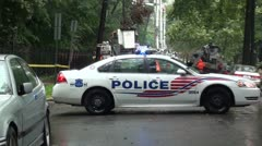 Police car. DC,  blocks road for electric pole repair, raining. Stock Footage