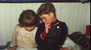 Sad boy wants sister to comfort him (Vintage 8 mm amateur film) Stock Footage