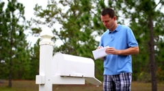 Checking Mail, Upset 2323 Stock Footage