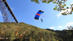 Base Jumper landing in the mark beside the New River Stock Footage