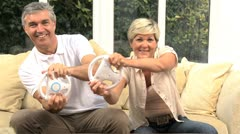 Middle Aged Caucasian Couple Playing on Games Console - stock footage