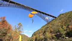 Base Jumper coming in for landing beside the New River Stock Footage
