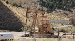 Oil well pumping crude mountain Utah P HD 0361 Stock Footage