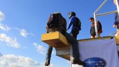 Base Jumper does back flip off platform on the New River Gorge Bridge Stock Footage