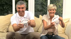 Middle Aged Couple Using Home Games Console Stock Footage