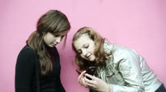 Stock Video Footage of two teenage girls consider phone