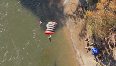 Base jumper landing at the edge of the New River Stock Footage