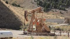 Oil well pumping crude mountain Utah fast P HD 0361 Stock Footage