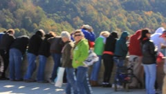 Passing by the crowds standing on and looking over the New River Gorge Bridge Stock Footage