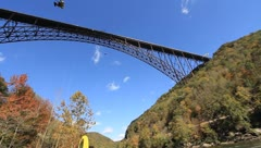 Base Jumpers in the New River Gorge at Bridge Day - stock footage