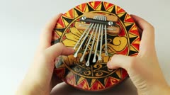 Person plays a musical instrument kalimba Stock Footage