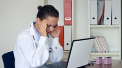 Young female doctor having headache in the office HD Stock Footage