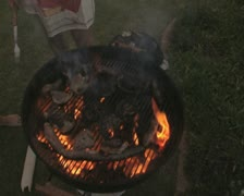 Close up of barbeque catching fire and being put out Stock Footage