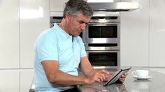 Mature Couple with Wireless Tablet Having Success Online Stock Footage