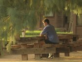 Stock Video Footage of Man sitting at bench