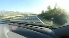 Driving a car on the open road Stock Footage