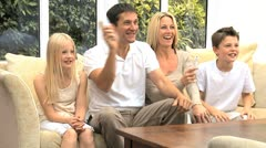 Parents Having Fun with Kids Games Console Stock Footage