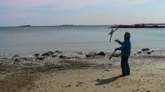 Juggler on beach Stock Footage