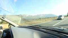 Car driving through the countryside Stock Footage