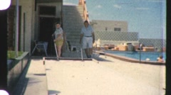 People Play SHUFFLEBOARD Game Vacation Game 1960s Vintage Film Home Movie 916 Stock Footage