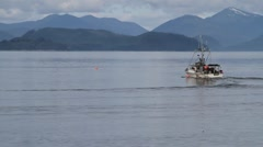 Alaska fishing fleet, boats ,blue mountains - stock footage