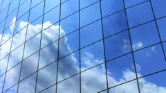 Skyscraper with airplane reflection in the clouds - stock footage