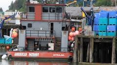 Alaska fishing fleet, boats at dock , fish crates Stock Footage