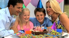 Young Caucasian Children Enjoying Birthday Celebrations - stock footage