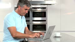 Mature Male with Laptop Having Success Online Stock Footage